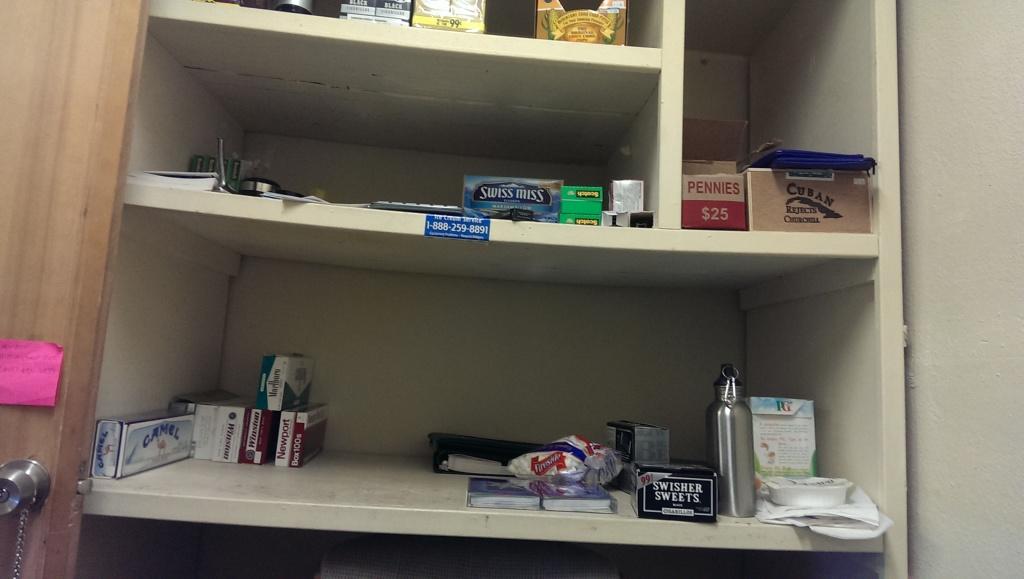The shelf next to the desk.